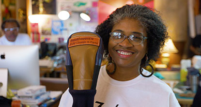 woman showing prosthetic leg made out of leather from seats