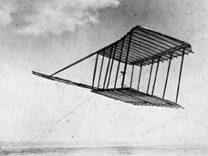 Testing their first glider as a kite in 1900.