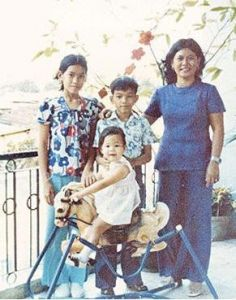 With Lam, my mother, and my cousin Lan on our balcony in Saigon