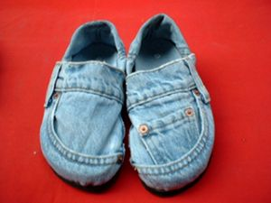 Jean-ius: Have an old pair of jeans?  Instead of throwing them out, why not make some shoes?  All you need is a hot glue gun, scissors, and a pair of flip flops.  Measure the jeans to your foot and glue the fabric accordingly.  I made a pair once in an art class in high school, and I still wear them to this day!