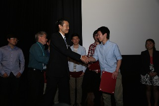 Konrad Ng hands out awards to youth filmmakers from across the country at the premier of Young Historians, Living Histories at CAAMFest 2014.