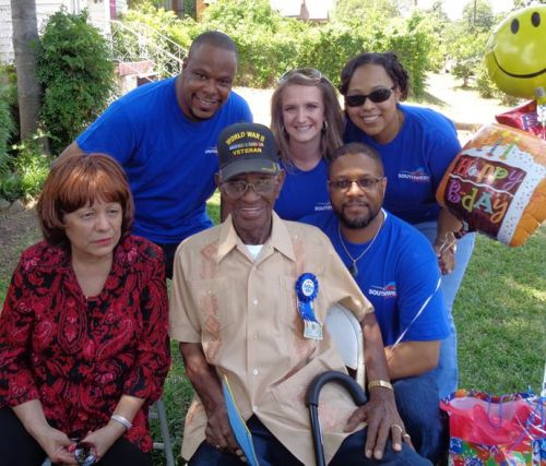 """A Team of Southwest Employees from Reagan National flew all the way to Austin on May 11 to visit their """"adopted"""" veteran, the oldest-living WWII veteran Sgt. Richard Overton. The Employees really showed their Servant's Hearts by surprising Sgt. Overton for his 108th birthday and bringing him Southwest goodies."""