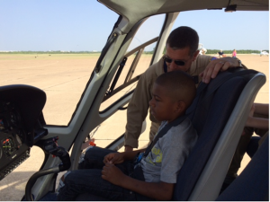 An Airbus Helicopter Pilot explains the controls to a student.