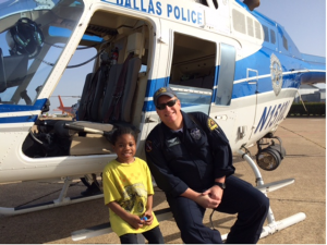 One of the students talks with a Dallas Police Department Pilot.