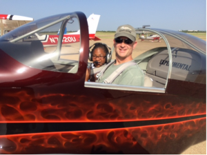 DAL First Officer Marc Hudson with his very excited copilot.