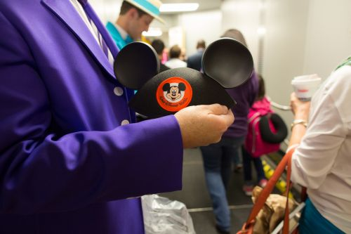The Dapper Dans from Disney hand out Mickey Mouse ears for the first non-stop flight from Dallas Love Field to Orlando, Florida. The Wright Amendment ended on Monday, Oct. 13 2014, allowing non-stop flights to anywhere in the U.S. from Dallas Love Field. / Stephen M. Keller, 2014
