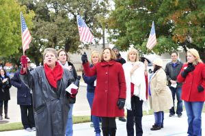 """Volunteers sing """"The Star-Spangled Banner"""" during the Meals on Wheels Blitz"""