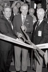 Herb cutting the ribbon, along with airfare, at Burbank