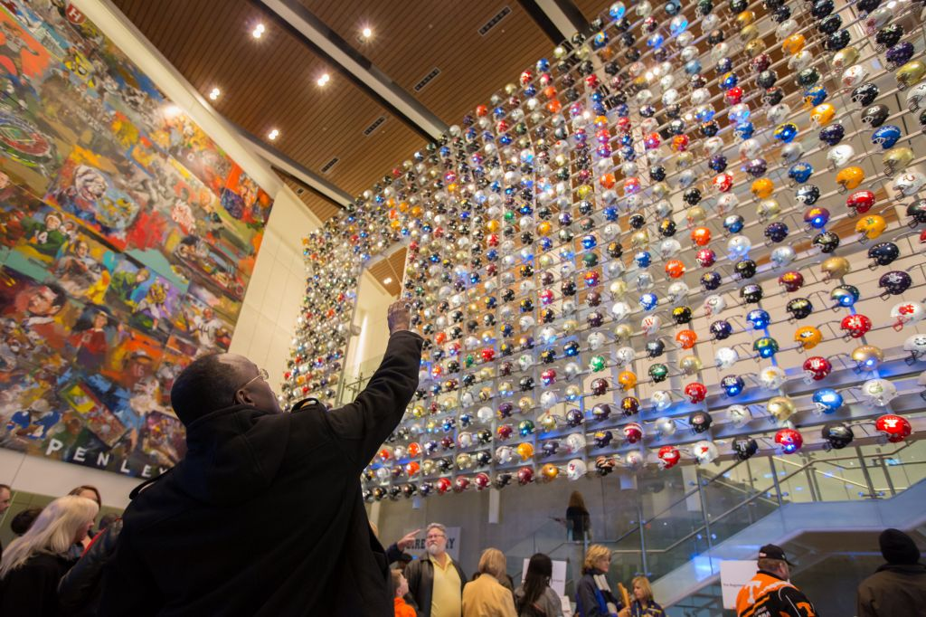 Employees check out a wall of helmets on display as Southwest Airlines recognizes it's Atlanta Employees with a celebration at the College Football Hall of Fame. // Stephen M. Keller