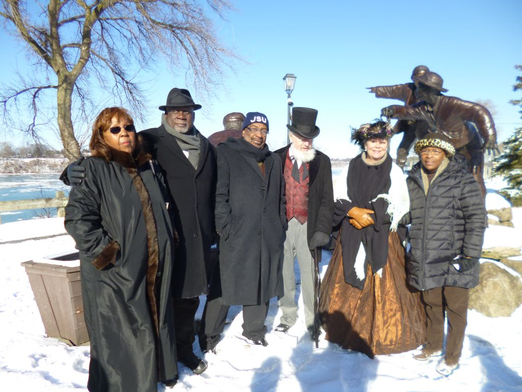 Four original Freedom Riders and reenactors at the Freedom Crossing Monument, Lewiston, NY. //  Photo credit: Lee Simonson