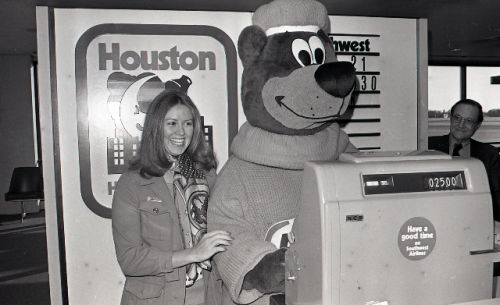 Rooty helping sell tickets to Hobby at the Gate Podium