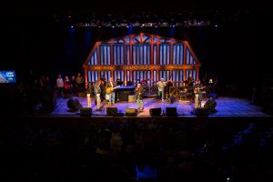 Southwest Airlines CEO Gary Kelly performs at the Grand Ole Opry with John Conlee. // Stephen M. Keller