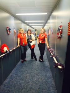 L-R Inflight Crew Base Coordinator Laura Nichols and Inflight Supervisors Maureen Manion Luterzo and Brenda Burget, decorate the jetbridge for each Honor Flight out of Las Vegas.
