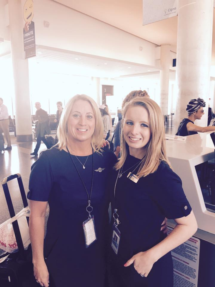 """Flight Attendant Roseann Ryle (left) and her daughter Amber share a sweet moment from when their paths recently crossed at Bradley International Airport in Hartford, CT. Amber is a Customer Service Agent based at BDL, and she enjoys seeing her mom whenever she is in town. Roseann has worked Inflight for ten years after her sister Madonna, who works as a Customer Service Supervisor in Orlando, convinced her to interview. They both love that they can have extensive conversations about Southwest and understand the """"lingo"""" of the company."""