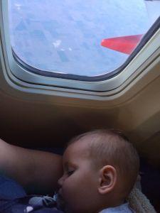 boy sleeping on plane