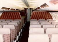 """The 300 Midcabin Lounges on the wings, looking aft. Both the 200's and 300's had these. """"When Southwest introduced the 737-700 in January 1998, new federal safety regulations doomed the lounge areas.  No rear-facing seats could meet this new safety requirement, and the -700s were delivered with all forward facing seating.  Lounges in the -300s and -500s were phased out, and only the -200 retained lounges until they were retired at the start of 2005."""""""