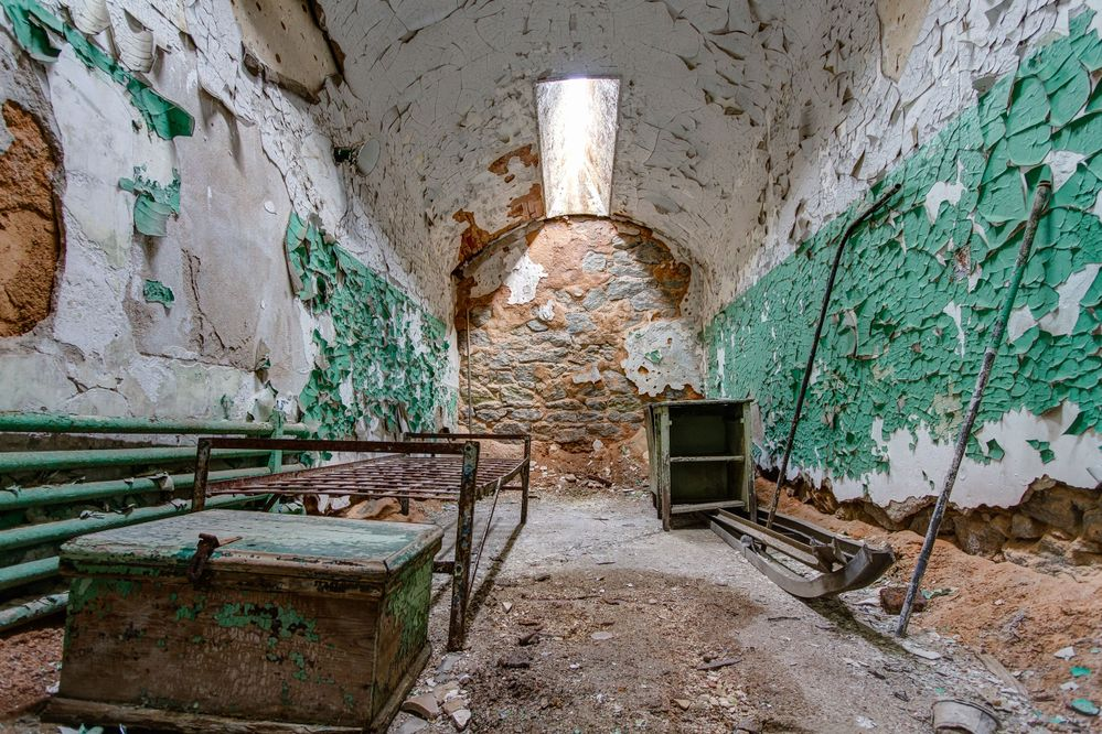 Prison cell in Eastern State Penitentiary, also known as ESP, is a former American prison in Philadelphia, Pennsylvania.