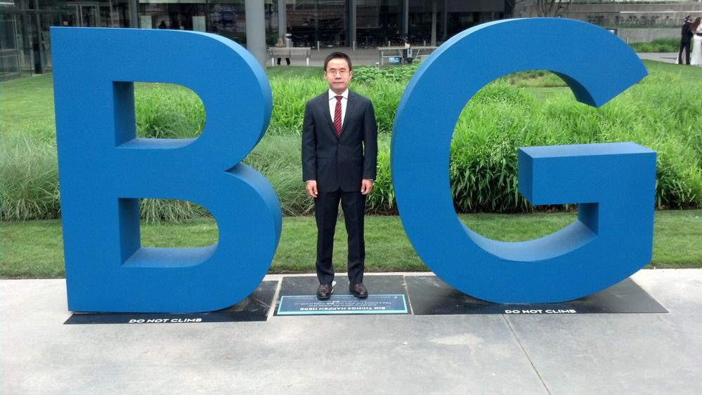 """Lin stands in the """"BIG"""" letters that can be found throughout Dallas."""