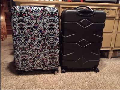Suitcase in question is on the left.