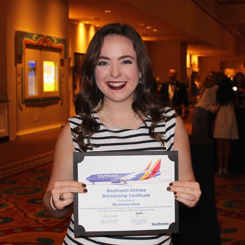 Mackenzie Odom receiving SWA Flight Training scholarship at Women in Aviation Conference 2017