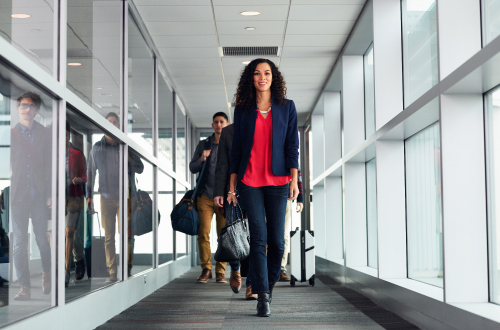 Woman walking confidently down a jetway